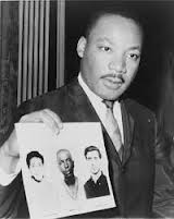 Martin Luther King holds flyer for Schwerner, Goodman and Chaney